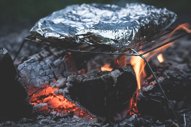 food in tinfoil on campfire