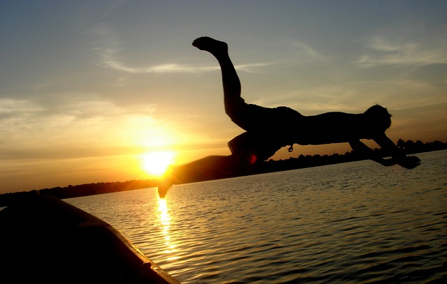 man-diving-lake