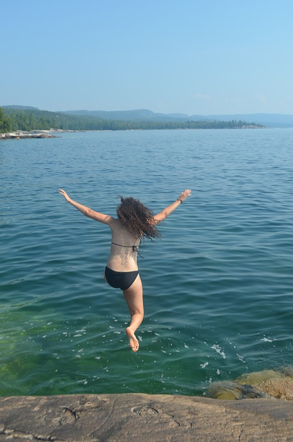 girl-jumping-into-lake