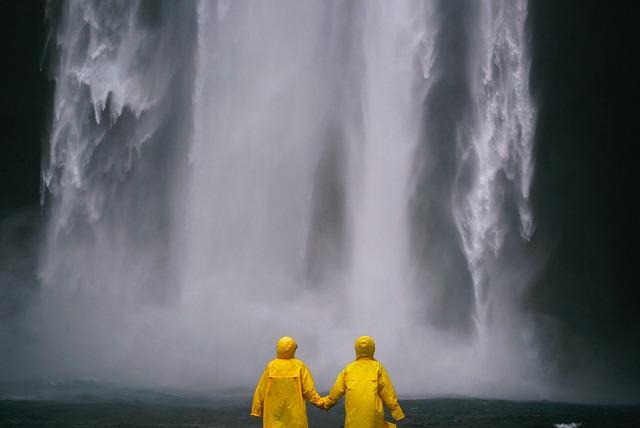couple wearing yellow raincoats