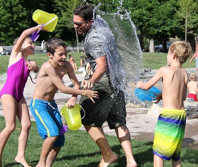 Dad And Kids Water Fight