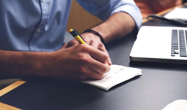 man writing plan