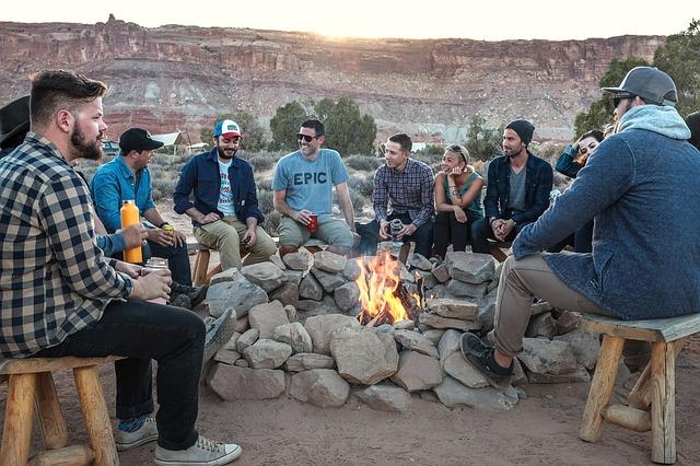 men-sitting-around-campfire